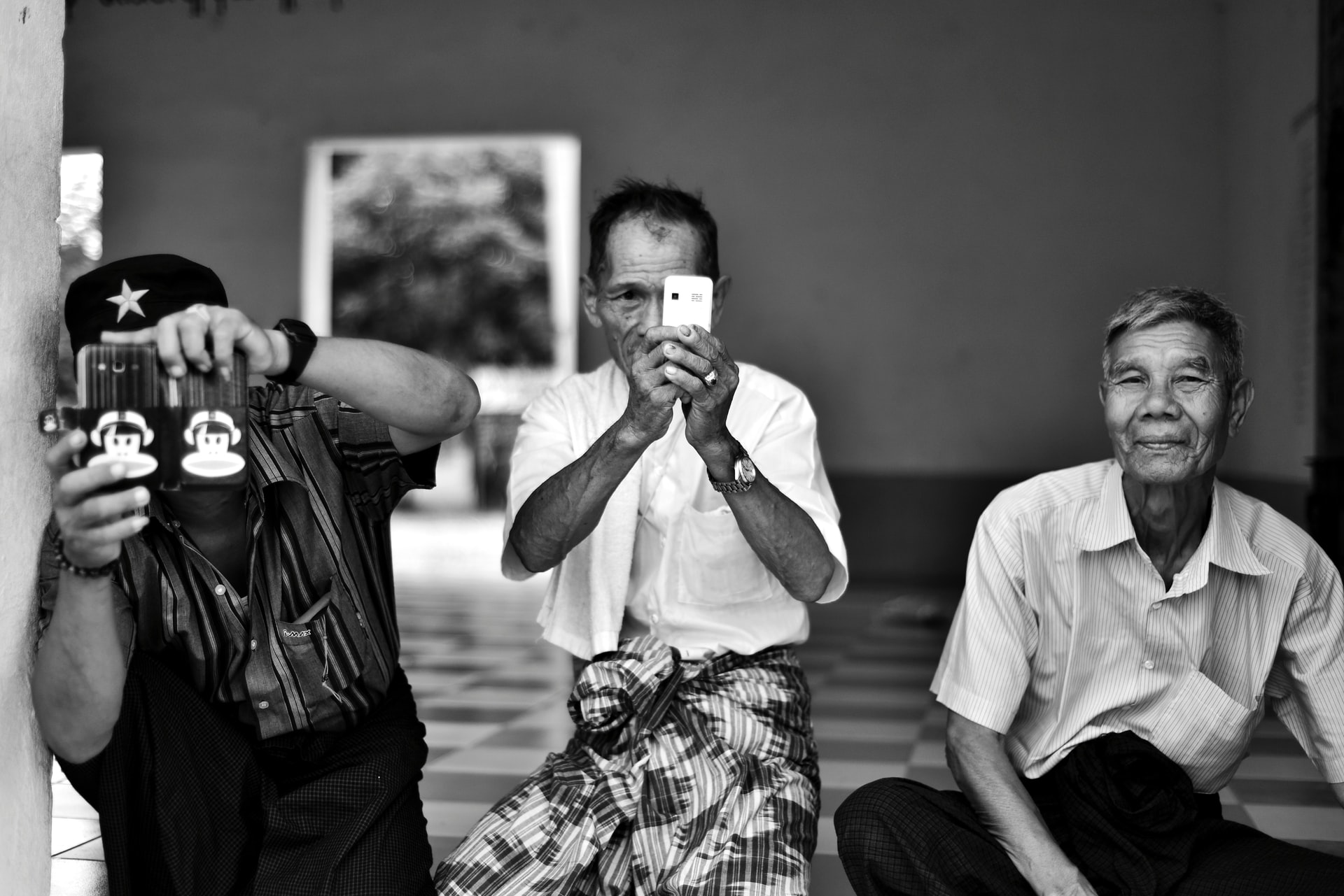 Phone users in Mandalay, Myanmar